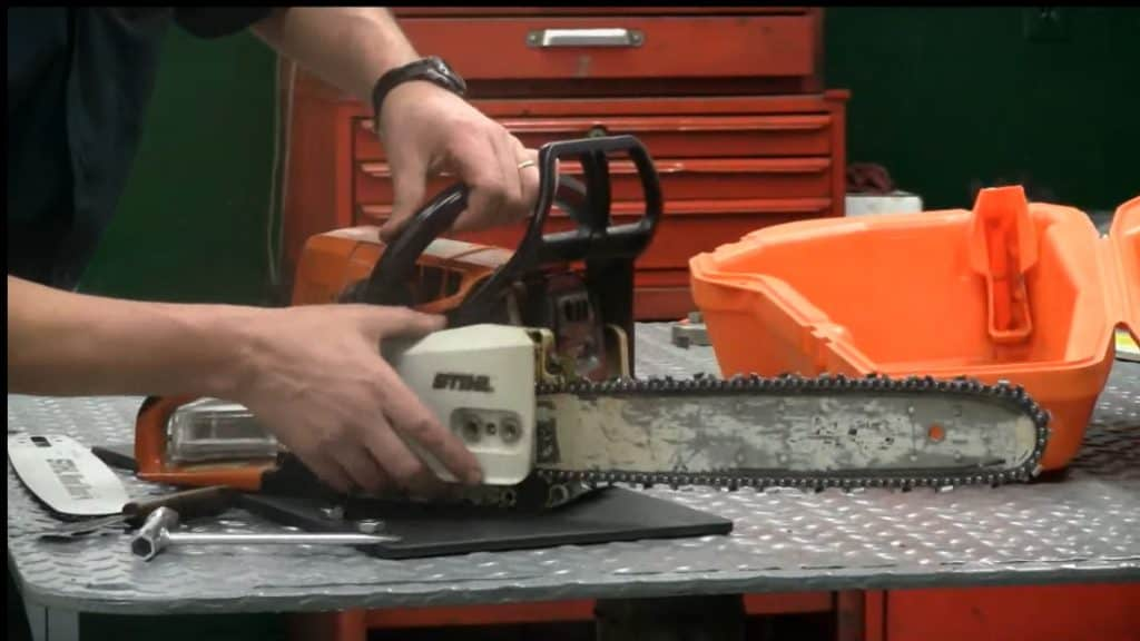 chainsaw chain replacement - reinstall side cover